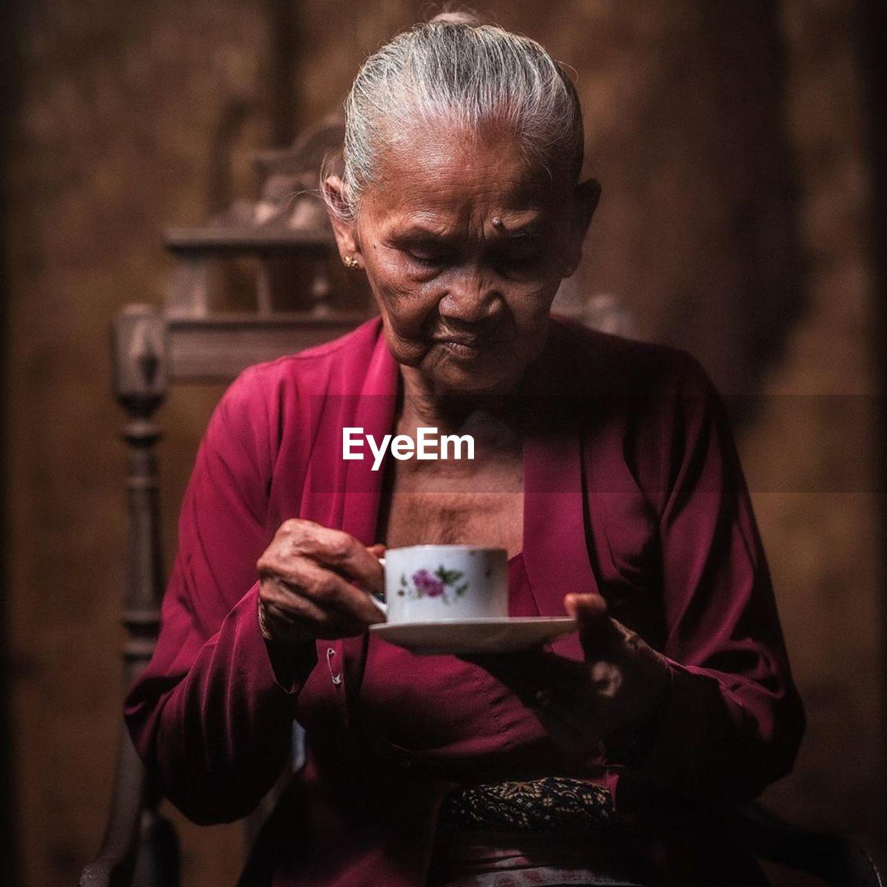Senior woman having tea