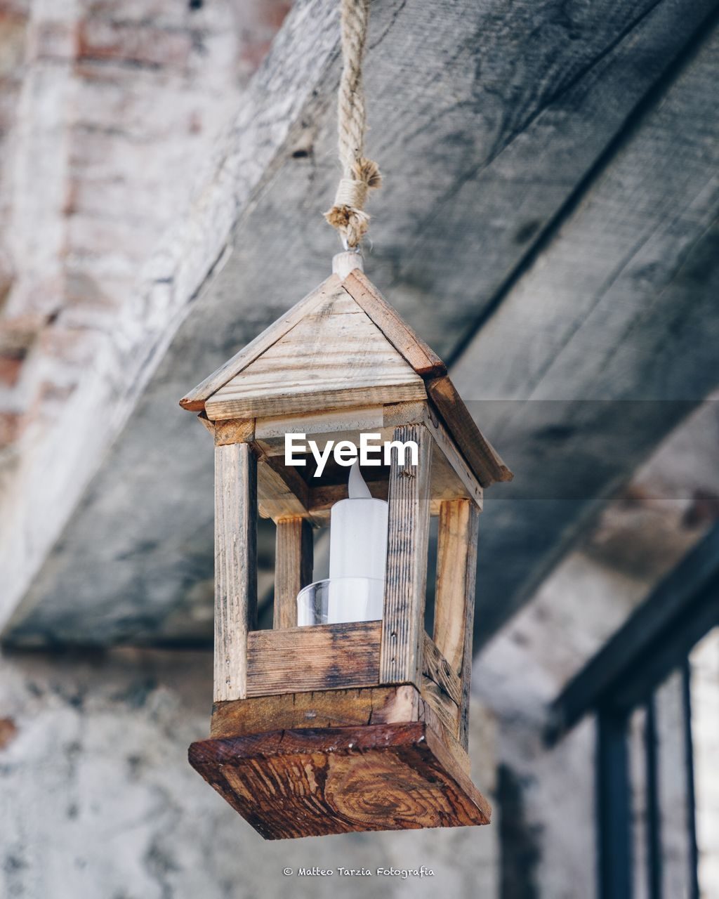Low angle view of wooden lantern hanging