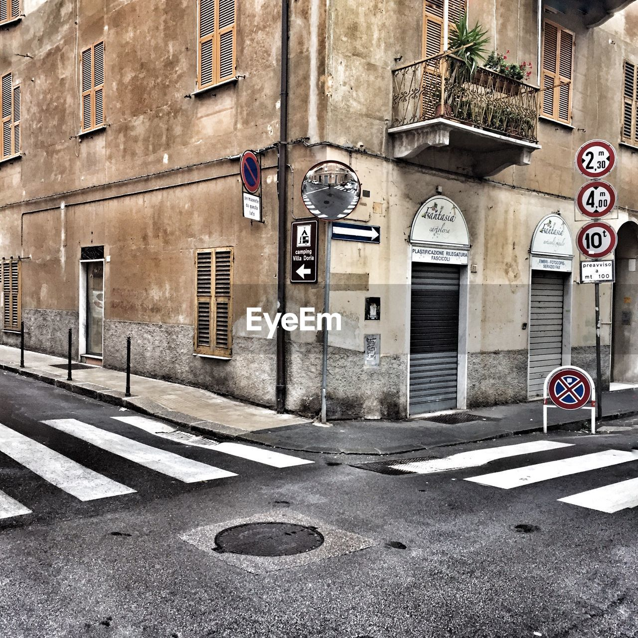 road sign, guidance, architecture, communication, built structure, building exterior, street, one way, outdoors, no people, day, road, city