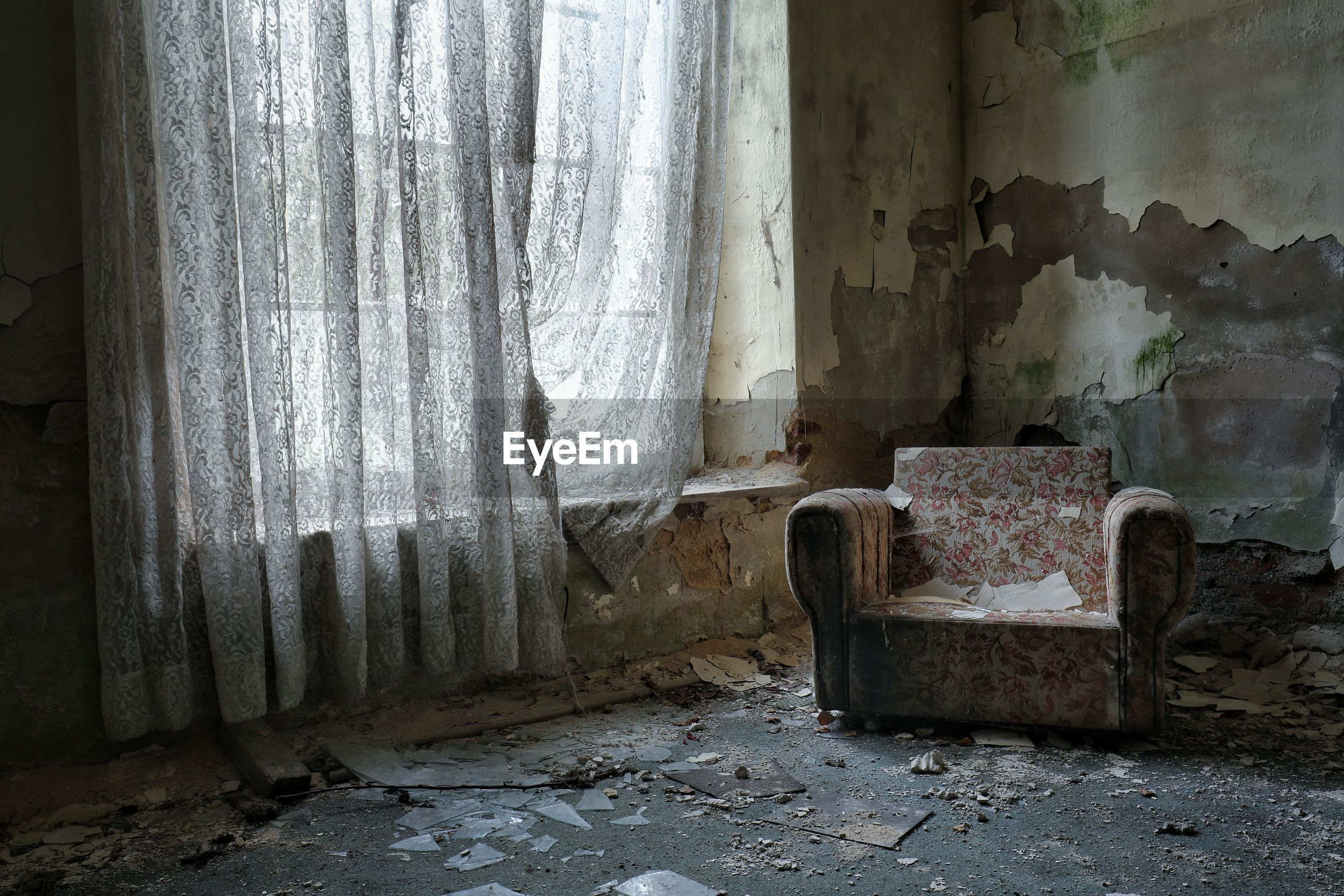 Empty chair in abandoned house