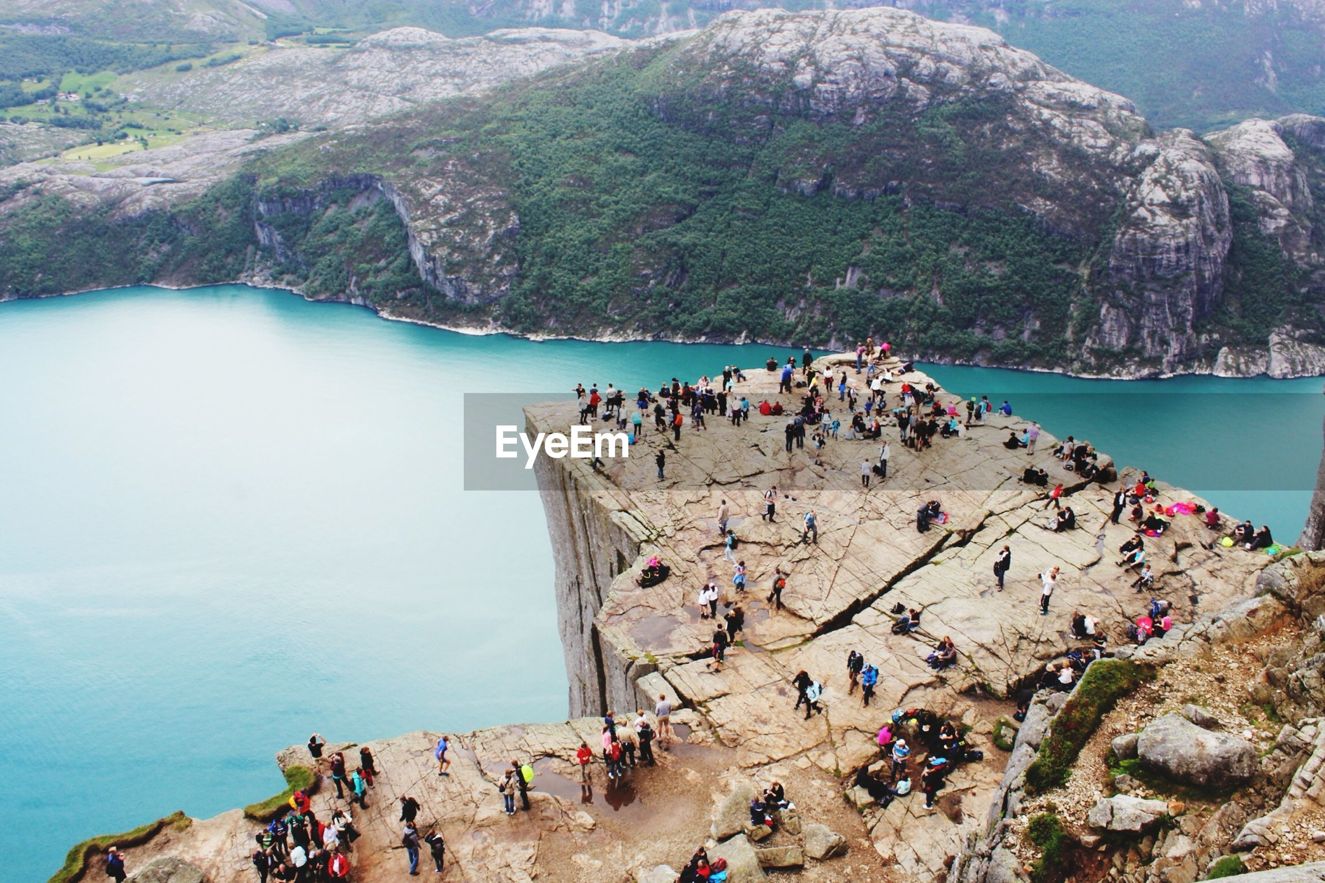 High angle view of people overlooking calm lake