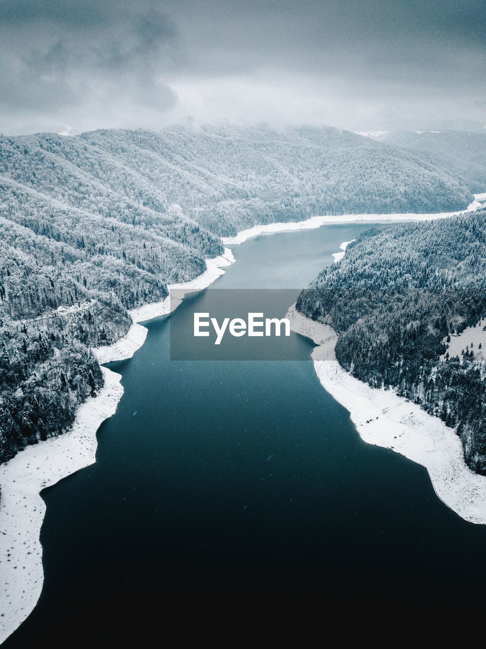 Aerial View Of River Against Sky During Winter