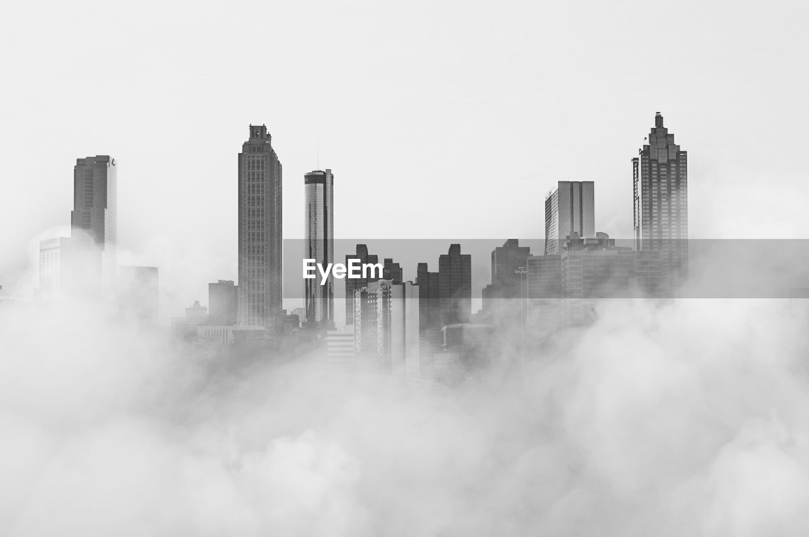 Smoke covering city against sky