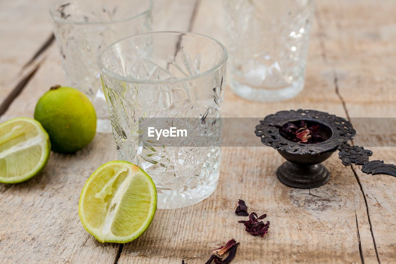 High angle view of drinking glass and ingredients on table