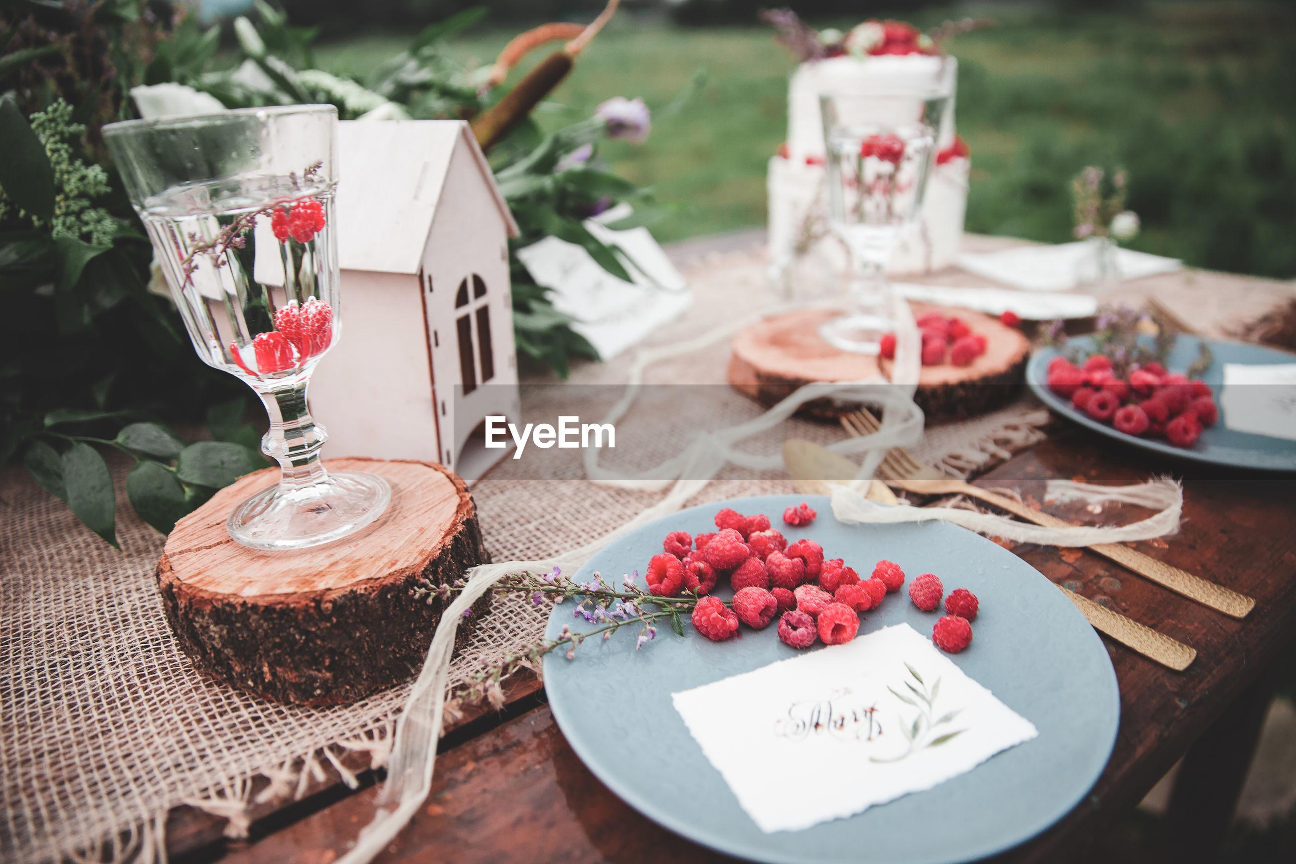 Raspberries in plate on table