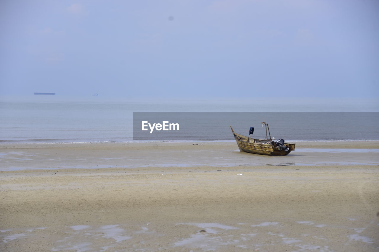sea, water, sky, horizon, beach, horizon over water, nautical vessel, land, transportation, mode of transportation, scenics - nature, beauty in nature, nature, day, tranquility, tranquil scene, sand, clear sky, no people, outdoors, anchored