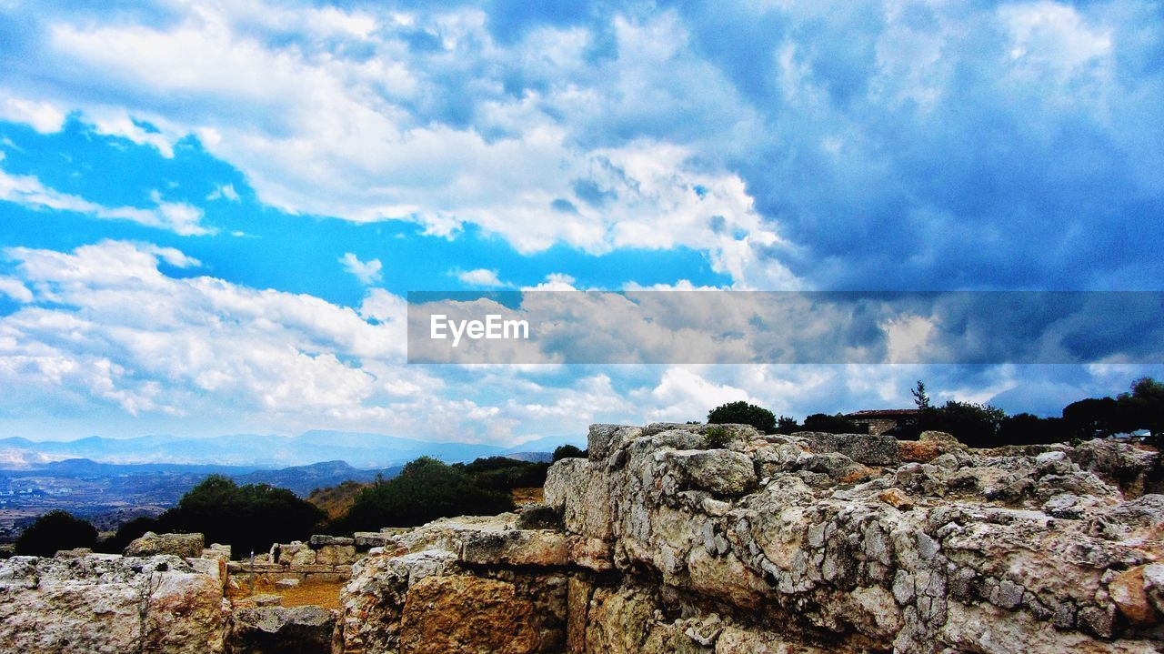 sky, cloud - sky, nature, rock - object, no people, beauty in nature, scenics, day, outdoors, mountain, landscape
