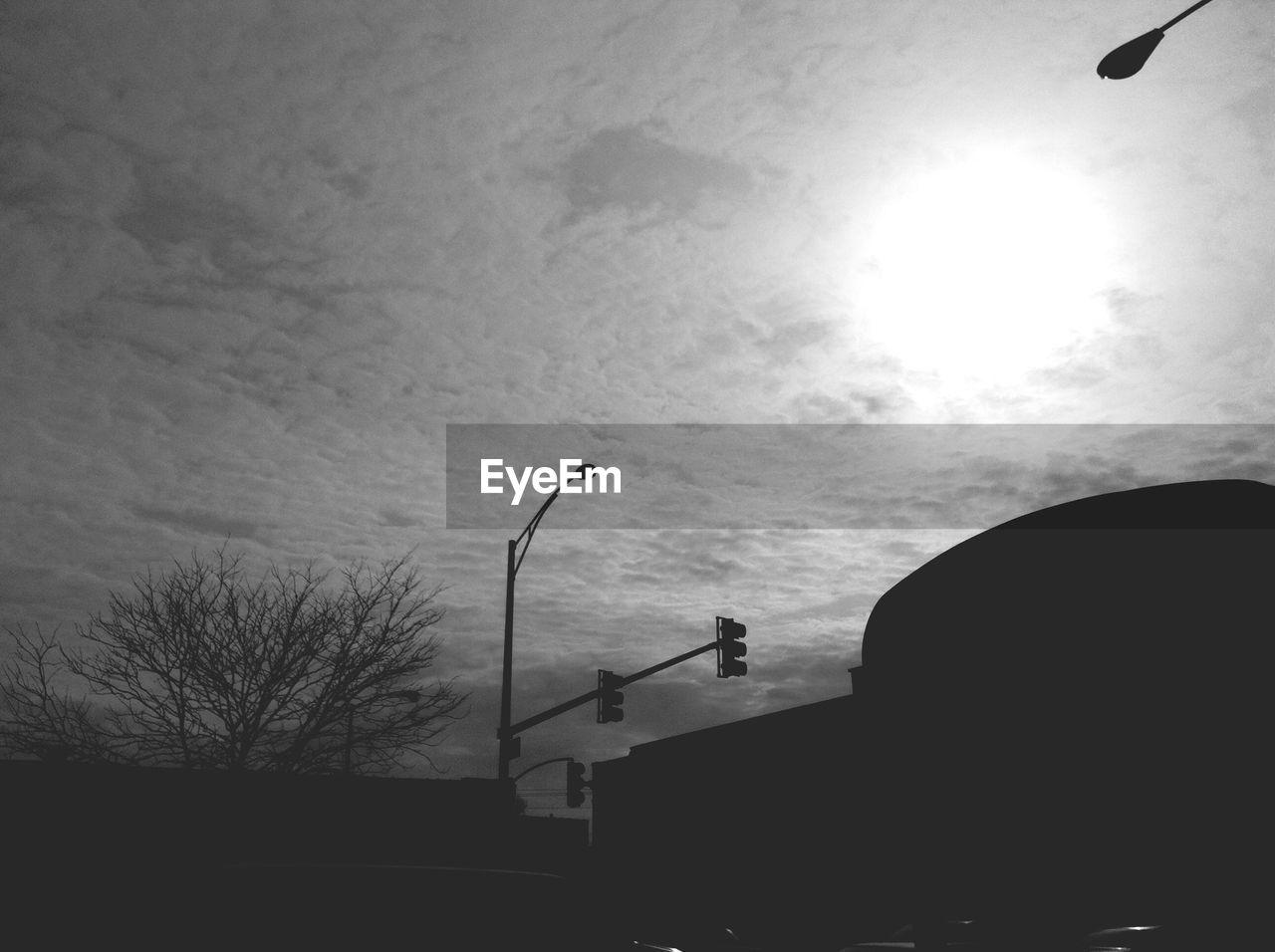 Silhouette buildings against sky