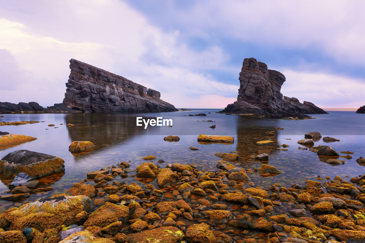 water, rock, sky, solid, rock - object, cloud - sky, scenics - nature, beauty in nature, sea, tranquility, tranquil scene, rock formation, nature, no people, beach, idyllic, non-urban scene, land, sunset, outdoors, rocky coastline
