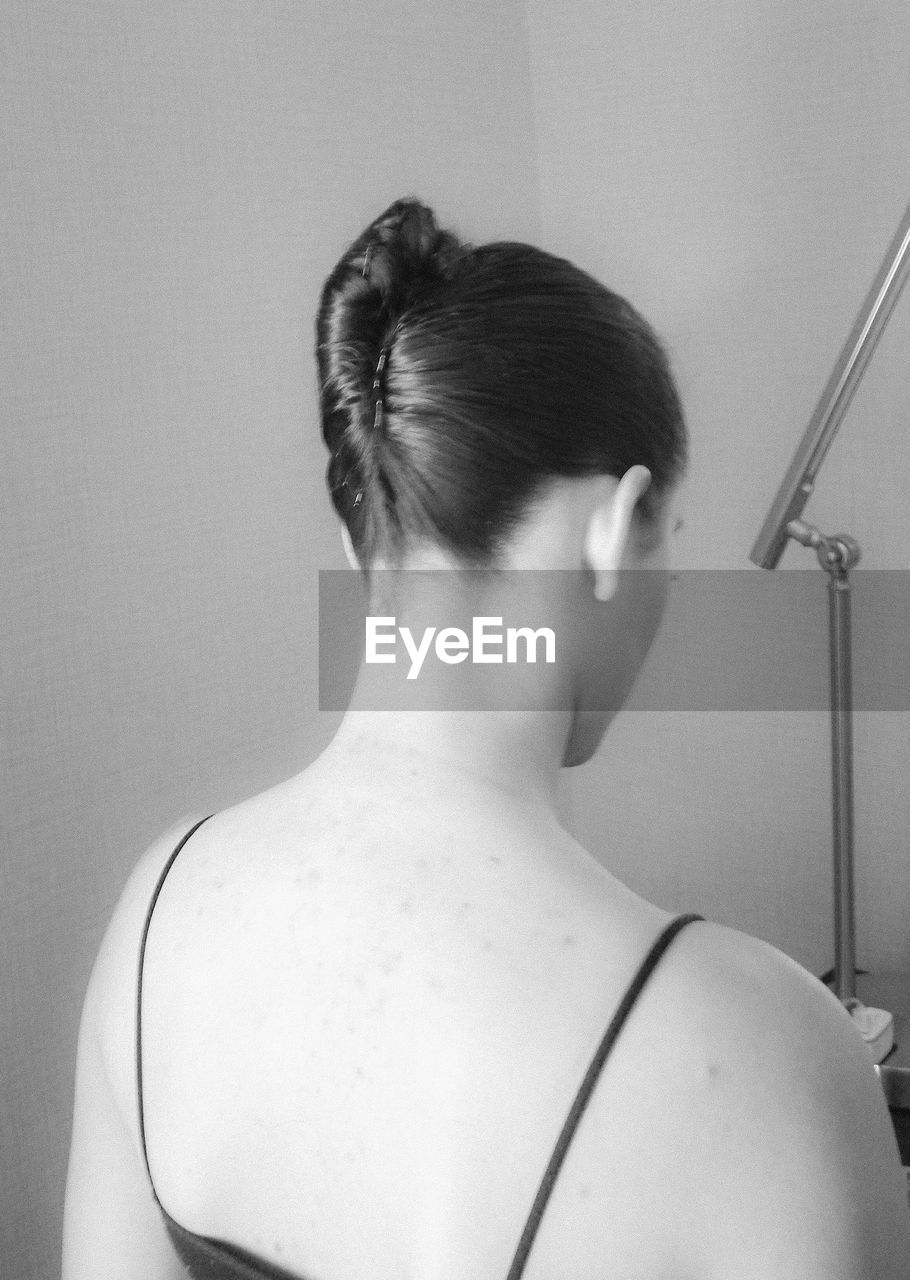 rear view, one person, real people, indoors, hair bun, women, lifestyles, young adult, human back, close-up, day, people
