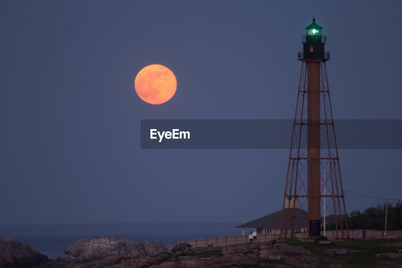 sky, moon, nature, tower, architecture, no people, beauty in nature, scenics - nature, built structure, night, clear sky, space, guidance, full moon, outdoors, astronomy, lighthouse, tranquility, tranquil scene, sea, planetary moon
