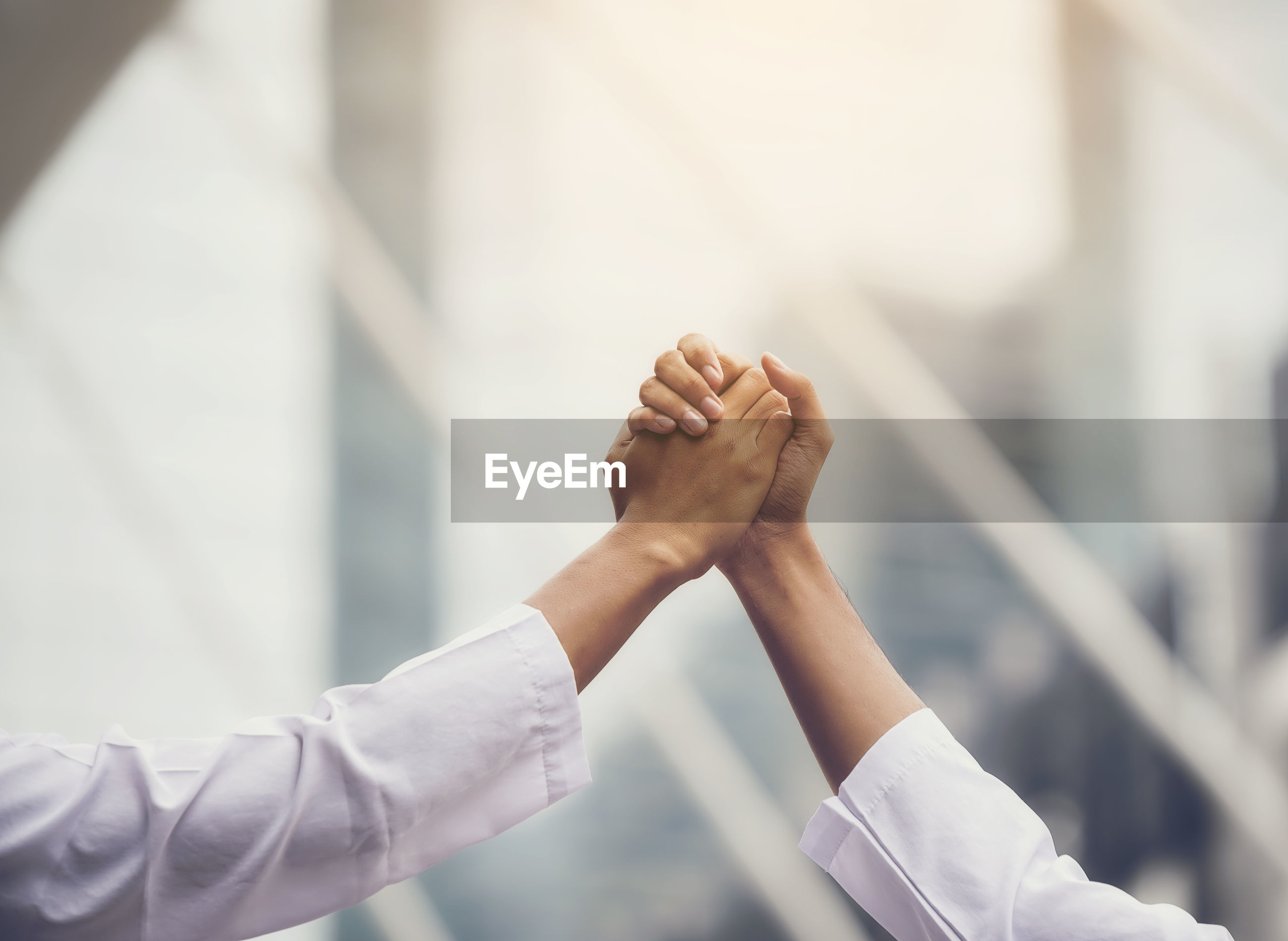 Cropped image of business people greeting each other outdoors