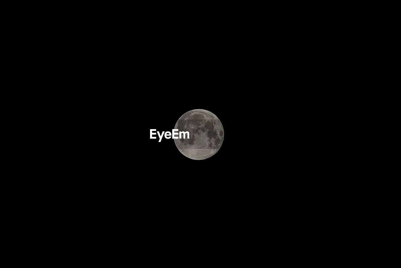 moon, space, astronomy, sky, planetary moon, beauty in nature, night, full moon, copy space, low angle view, tranquility, circle, scenics - nature, clear sky, tranquil scene, moon surface, geometric shape, nature, no people, shape, outdoors, dark, space and astronomy, astrology, moonlight