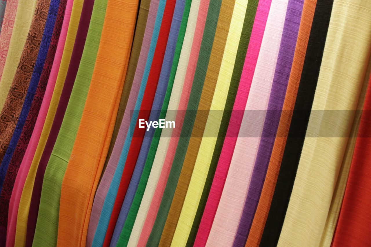 Full frame shot of colorful fabrics for sale in clothing store