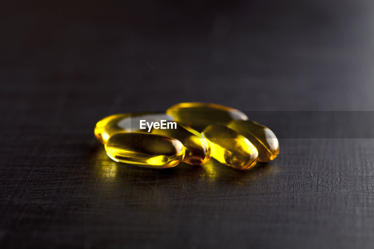 Close-up of cod liver oil capsule on table