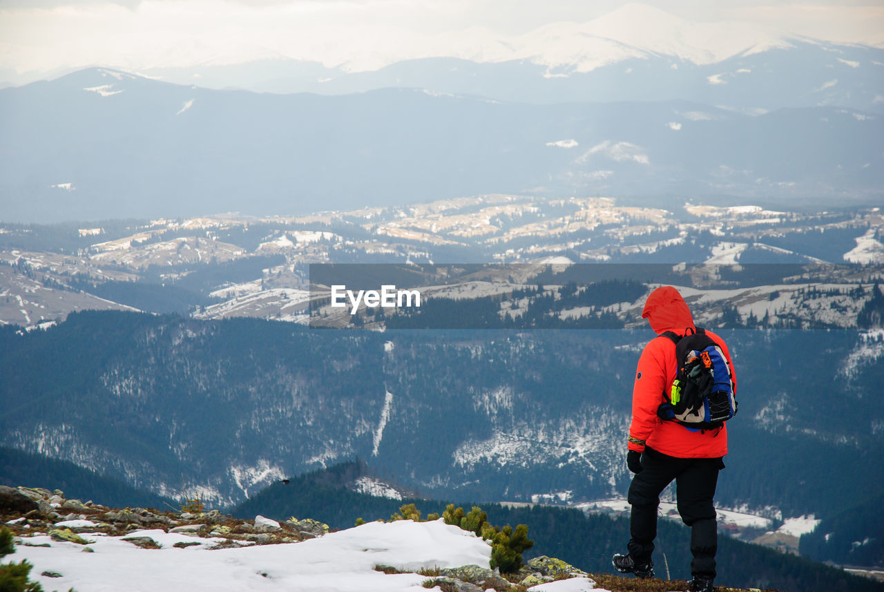 Rear View Of Hiker On Mountain During Winter