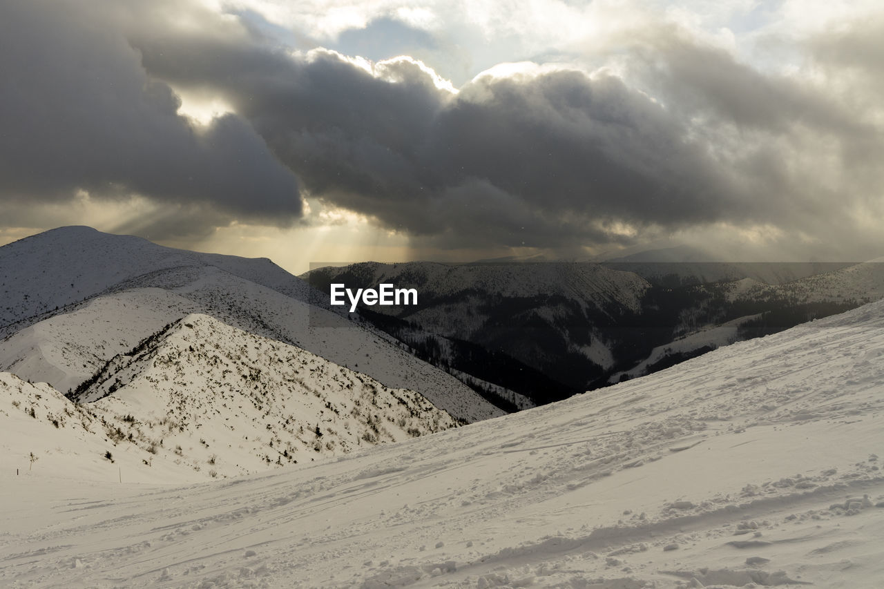 scenics - nature, snow, sky, beauty in nature, winter, cloud - sky, cold temperature, mountain, tranquility, tranquil scene, environment, landscape, nature, no people, non-urban scene, day, land, mountain range, snowcapped mountain, climate, arid climate