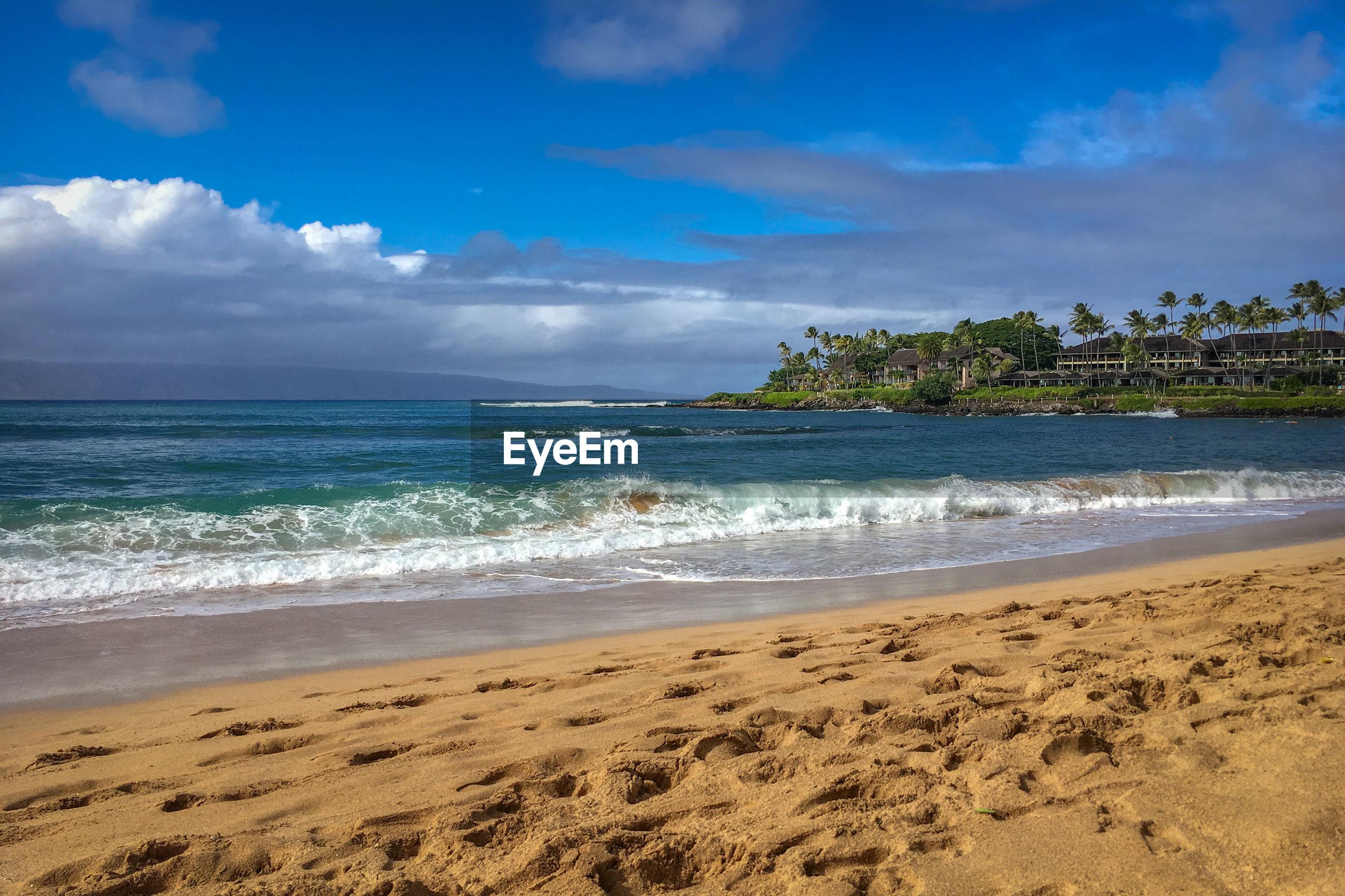 Scenic view of napili bay beach on the hawaiian island of maui, usa against sky