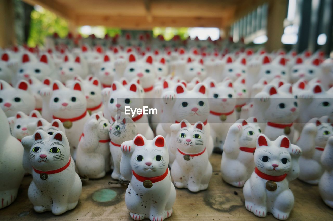 Maneki neko cats at market for sale