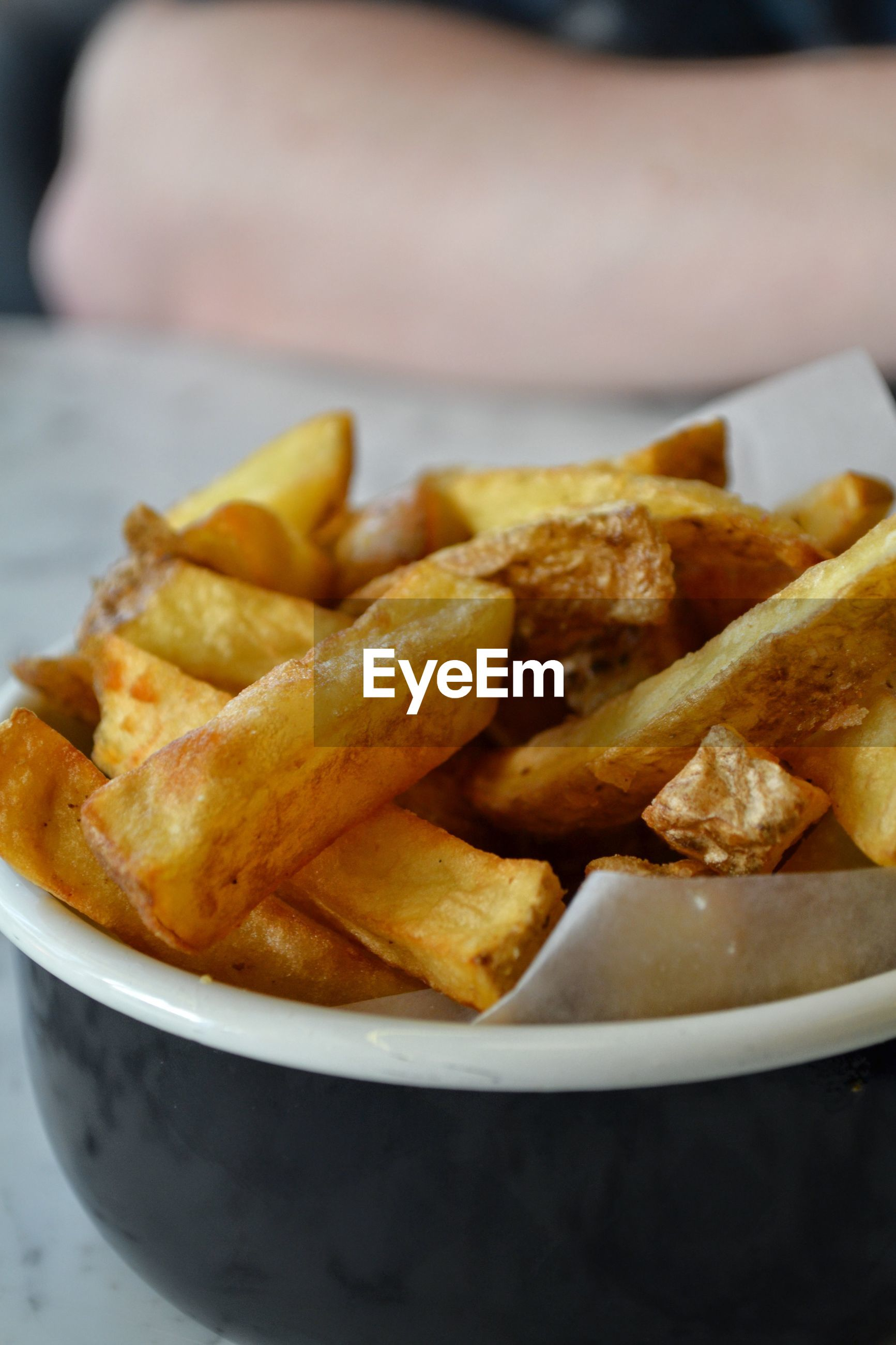 Close-up of french fries in bowl on table