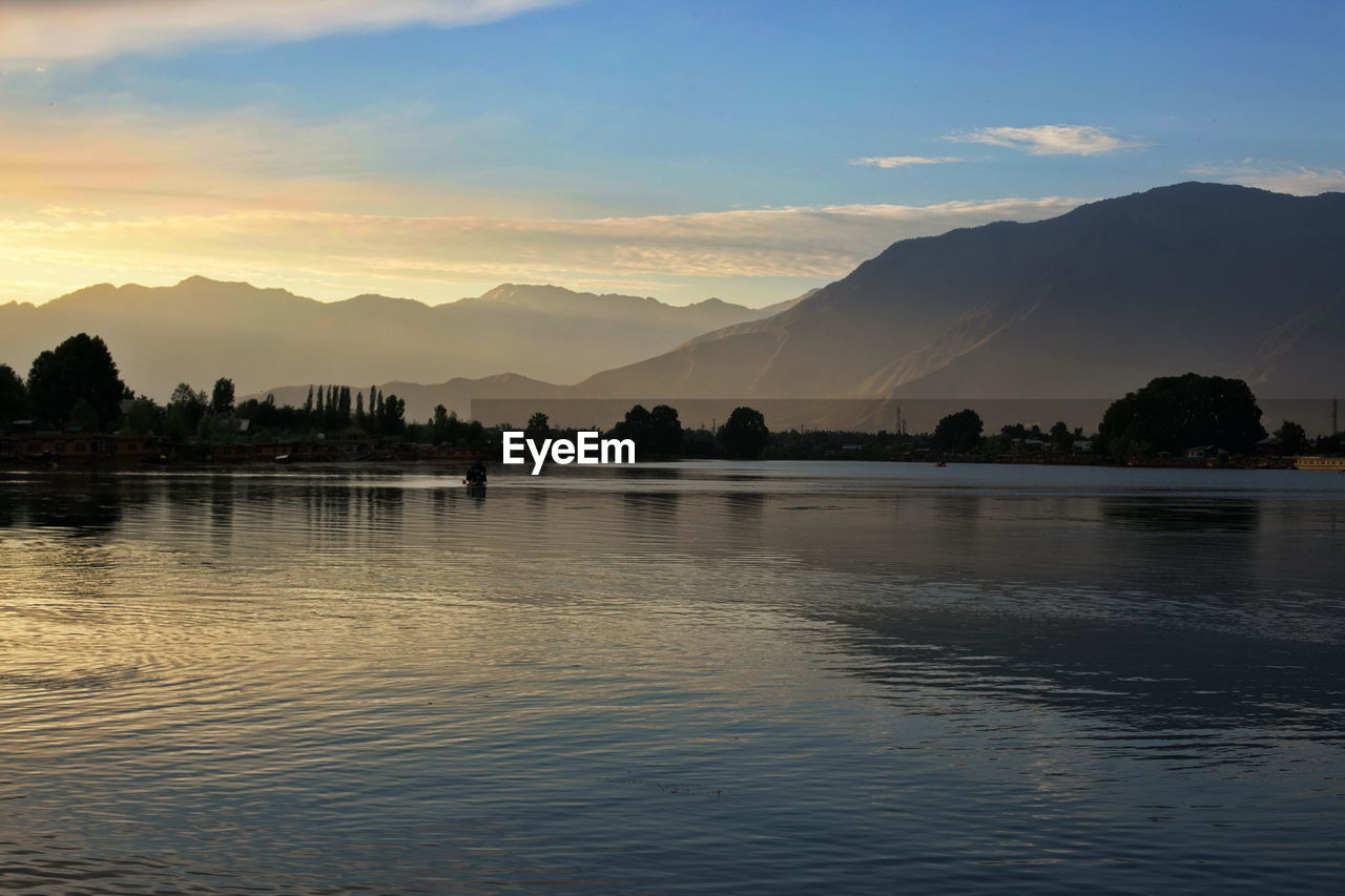 water, sky, mountain, beauty in nature, scenics - nature, sunset, tranquil scene, waterfront, tranquility, cloud - sky, silhouette, reflection, nature, mountain range, lake, idyllic, no people, non-urban scene, outdoors