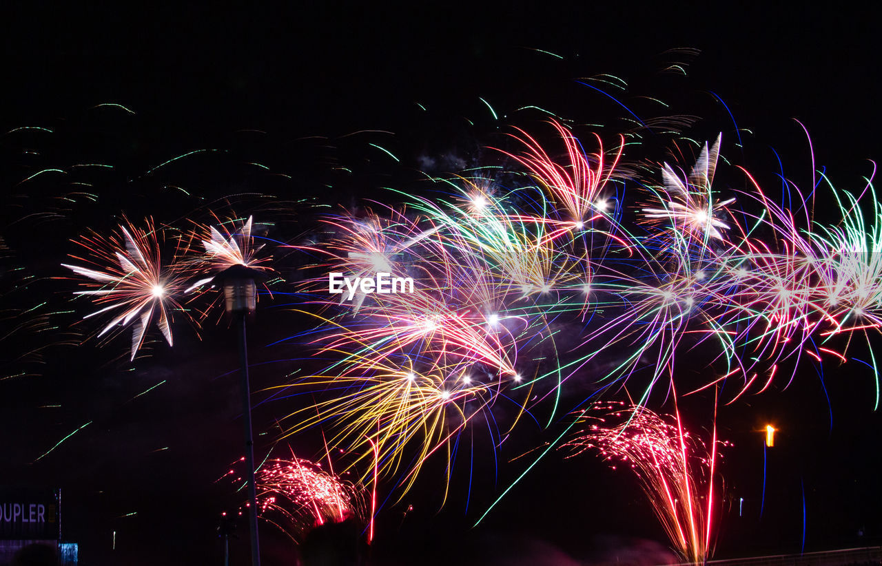 night, illuminated, celebration, firework, event, motion, arts culture and entertainment, firework display, glowing, exploding, long exposure, multi colored, low angle view, firework - man made object, blurred motion, light, no people, sky, sparks, nature