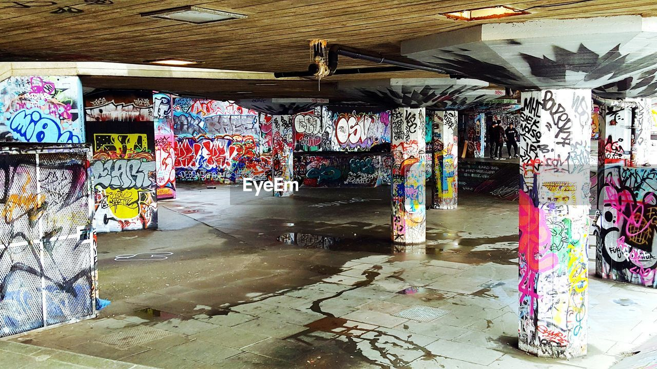 graffiti, multi colored, variation, indoors, large group of objects, choice, no people, day, hanging, built structure, architecture