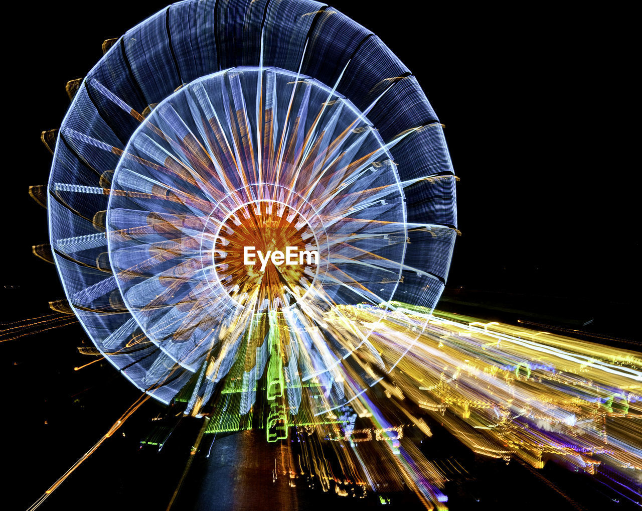 illuminated, night, amusement park, ferris wheel, amusement park ride, arts culture and entertainment, sky, motion, low angle view, no people, long exposure, pattern, blurred motion, architecture, spinning, speed, glowing, multi colored, nature, clear sky, fairground