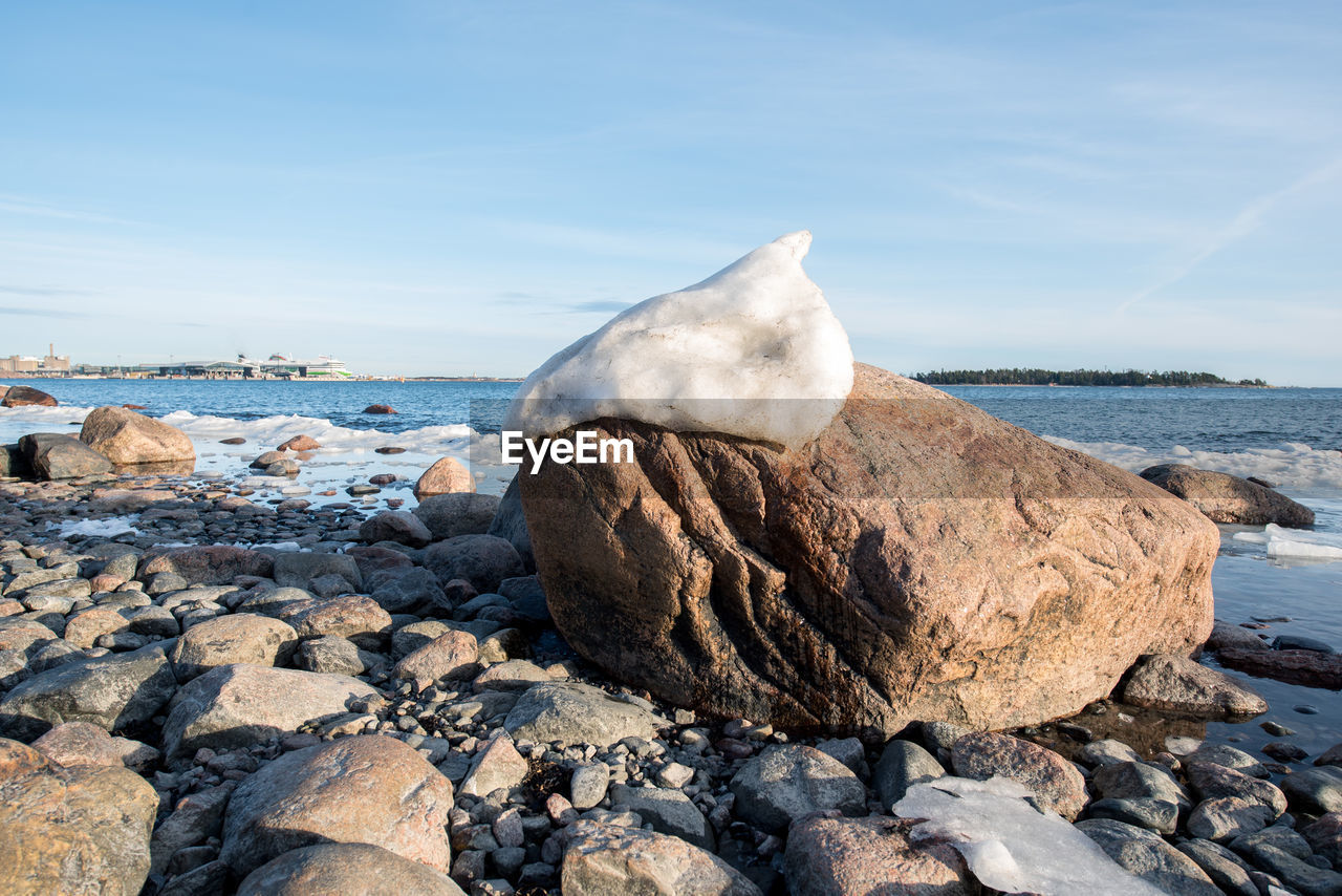 Close-Up Of Snow On Rock At Beach