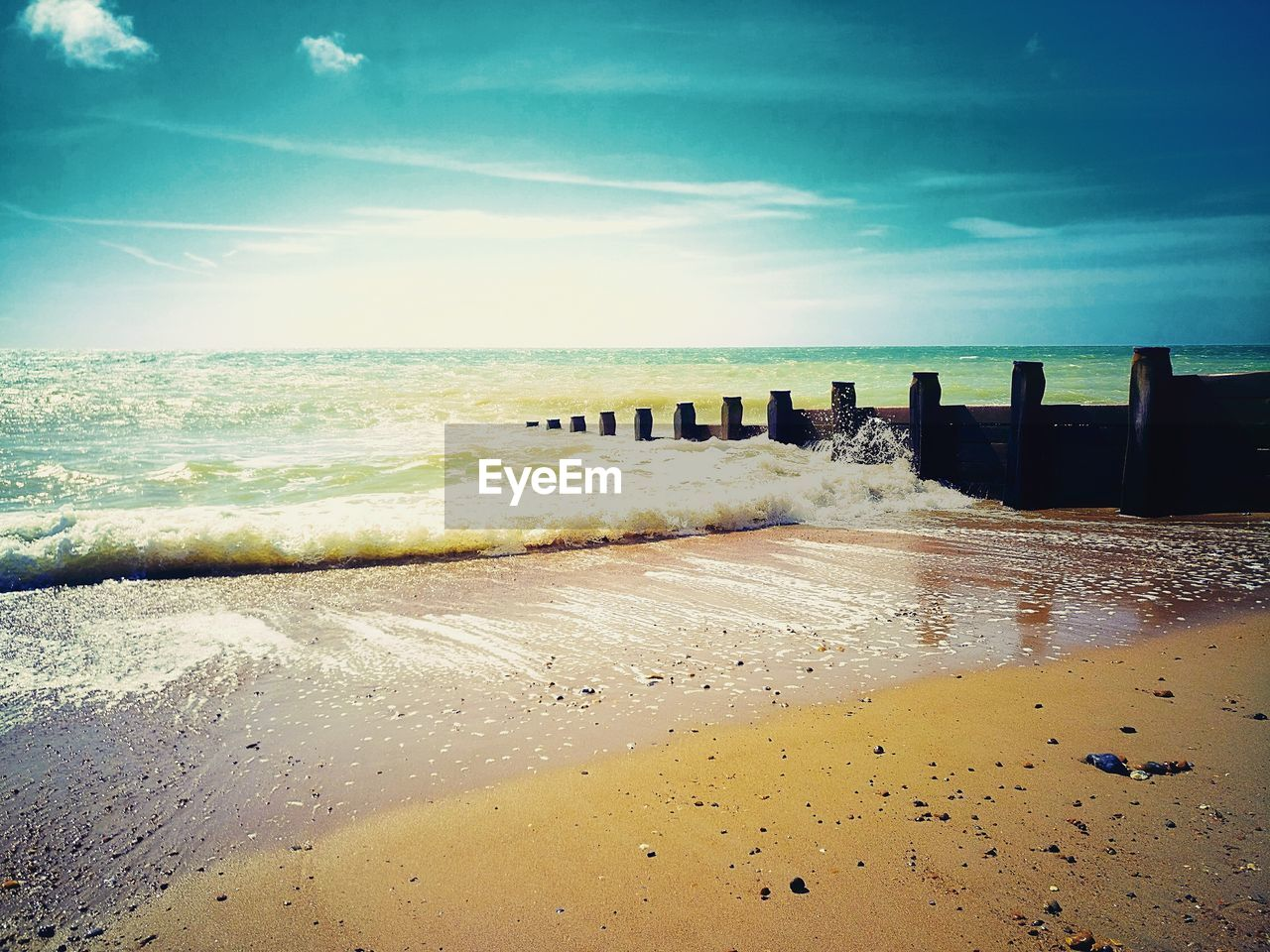 water, beach, sea, land, sky, wave, scenics - nature, horizon over water, motion, sand, beauty in nature, horizon, cloud - sky, nature, tranquil scene, tranquility, day, aquatic sport, surfing, wooden post, post, outdoors, groyne