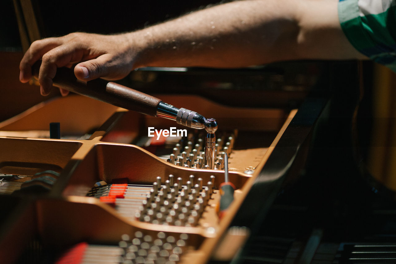 Cropped Image Of Hand Working On Piano