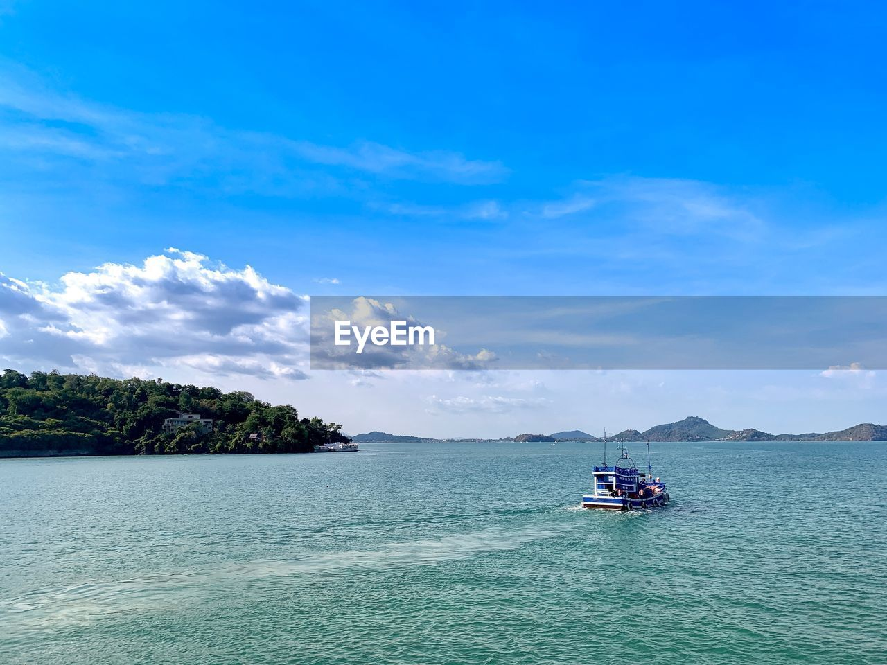 water, nautical vessel, sky, transportation, mode of transportation, cloud - sky, sea, scenics - nature, beauty in nature, waterfront, tranquility, tranquil scene, nature, day, travel, no people, blue, sailing, idyllic, outdoors, passenger craft