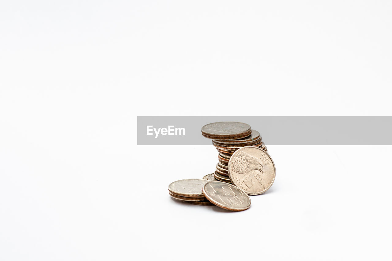 Close-up of coins against white background