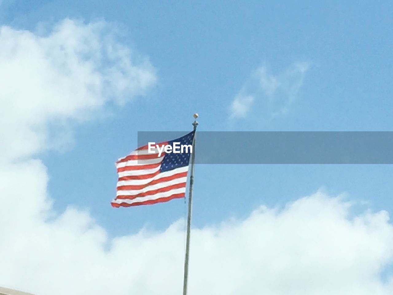 flag, patriotism, low angle view, striped, flag pole, stars and stripes, sky, cloud - sky, day, no people, blue, outdoors