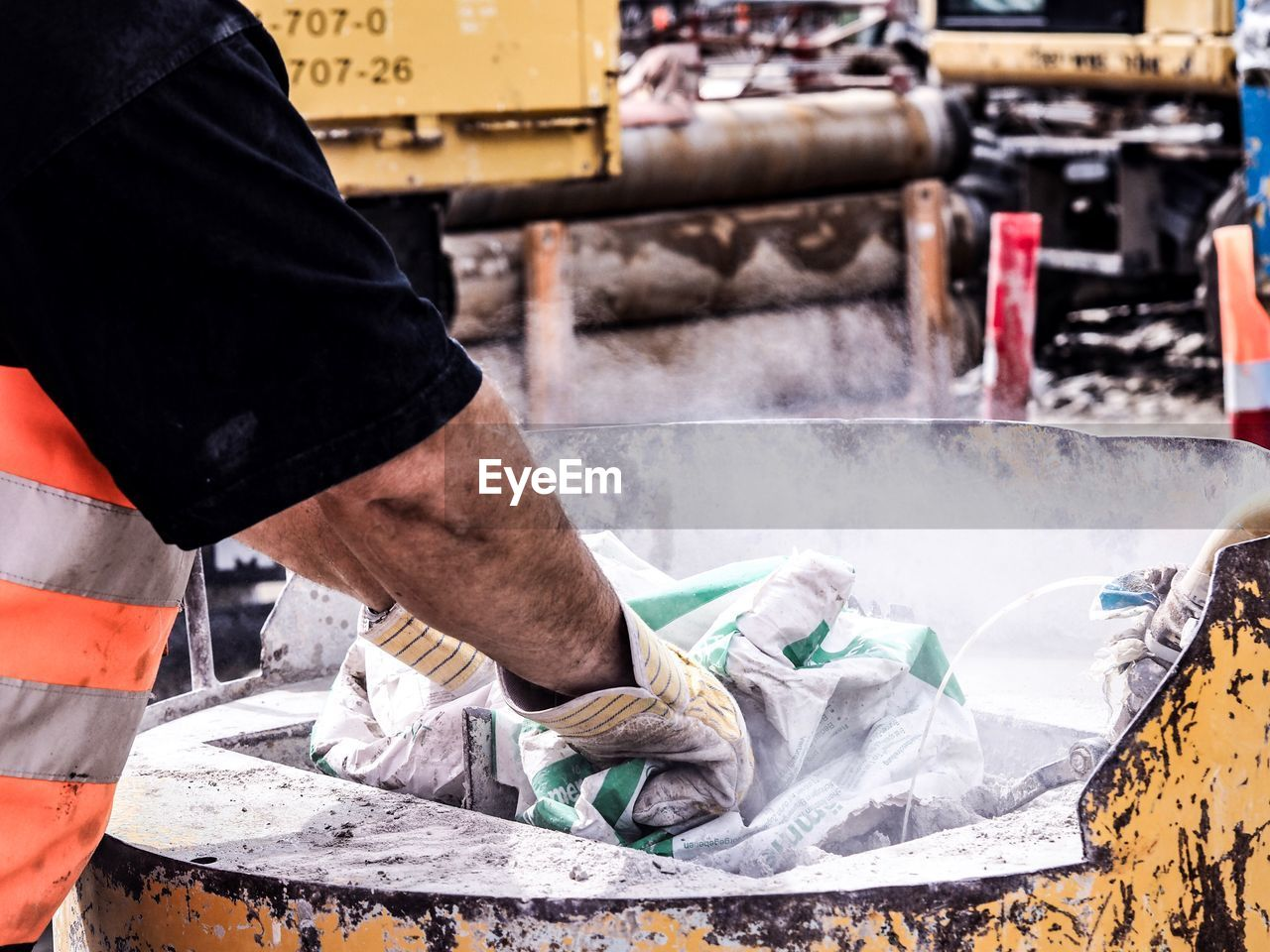 Midsection Of Manual Worker Working At Factory