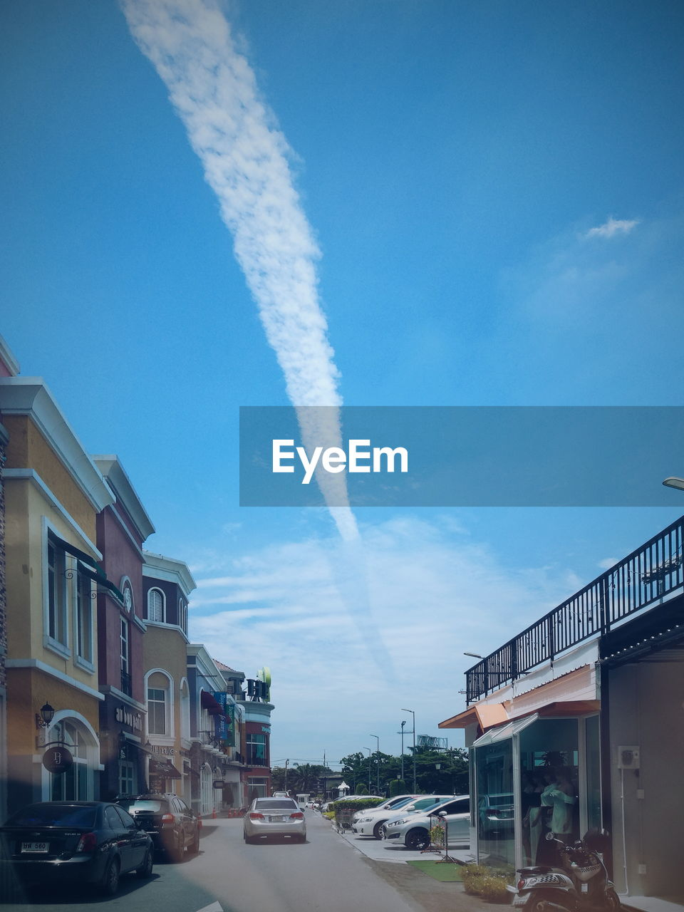 architecture, sky, transportation, mode of transportation, building exterior, built structure, cloud - sky, on the move, city, motor vehicle, day, vapor trail, car, nature, motion, no people, smoke - physical structure, blue, outdoors, air vehicle, pollution