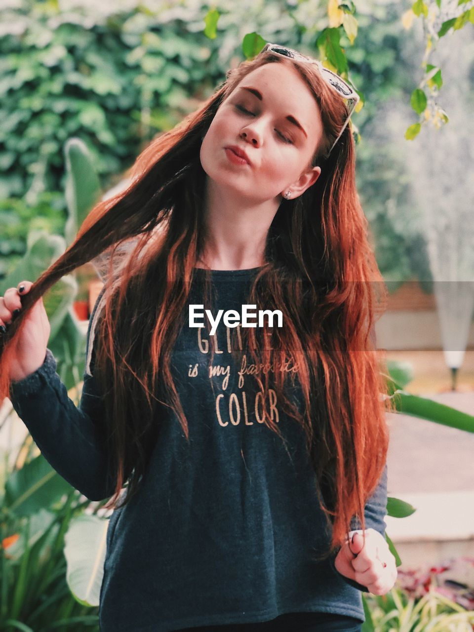 long hair, one person, hairstyle, hair, front view, casual clothing, young women, young adult, leisure activity, real people, beauty, focus on foreground, lifestyles, waist up, beautiful woman, standing, women, portrait, brown hair, outdoors, teenager, contemplation, dyed hair