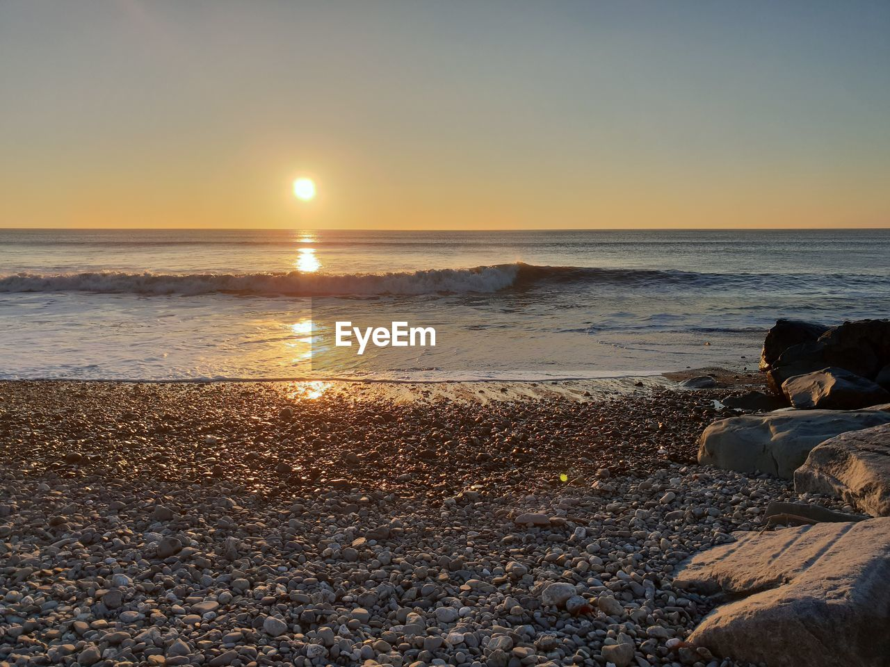 sky, water, beach, sea, land, scenics - nature, horizon, sunset, horizon over water, rock, beauty in nature, solid, rock - object, tranquility, tranquil scene, nature, stone, pebble, stone - object, no people, outdoors