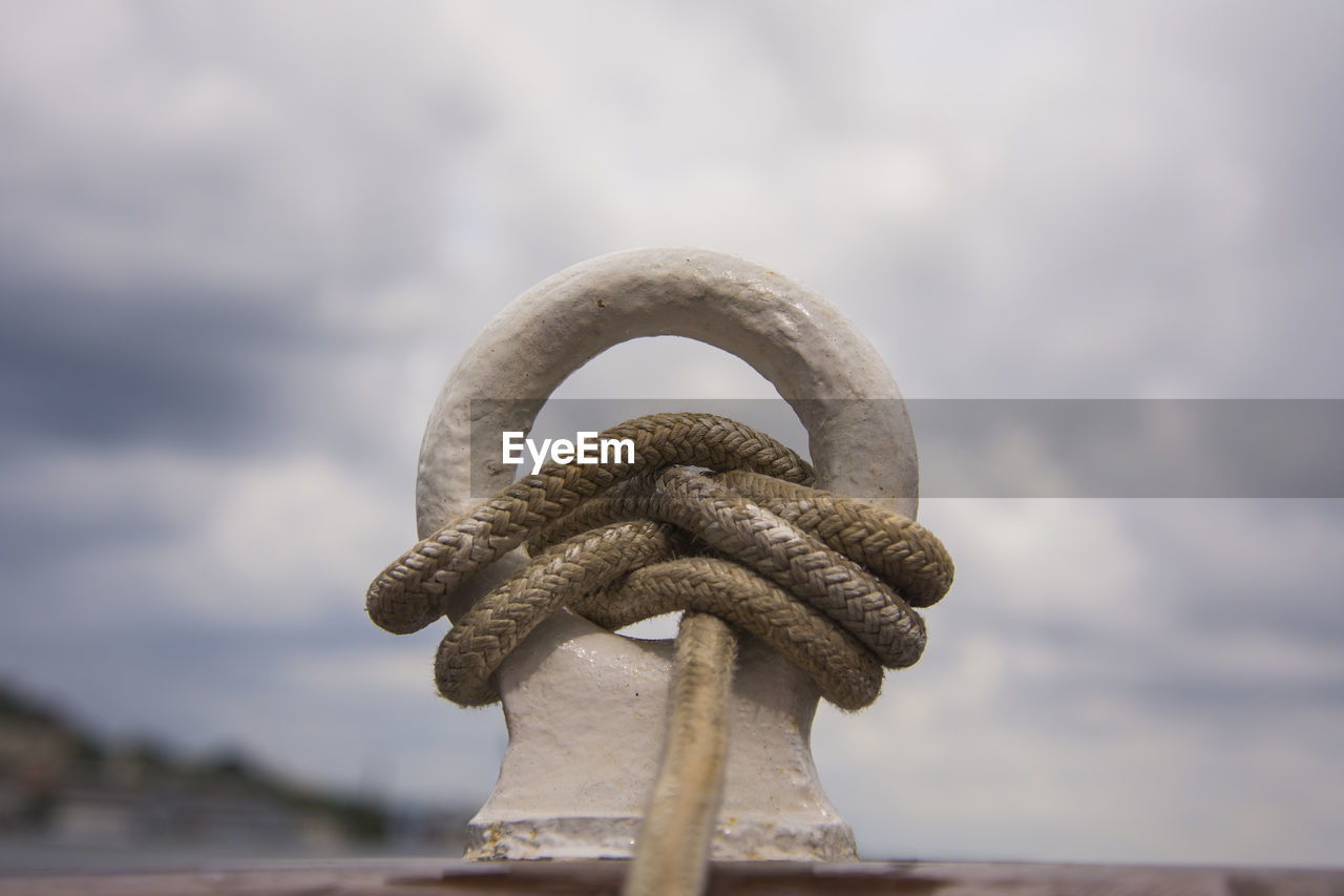 sky, cloud - sky, no people, close-up, metal, focus on foreground, nature, day, strength, water, tied up, rope, connection, outdoors, safety, sea, shape, transportation