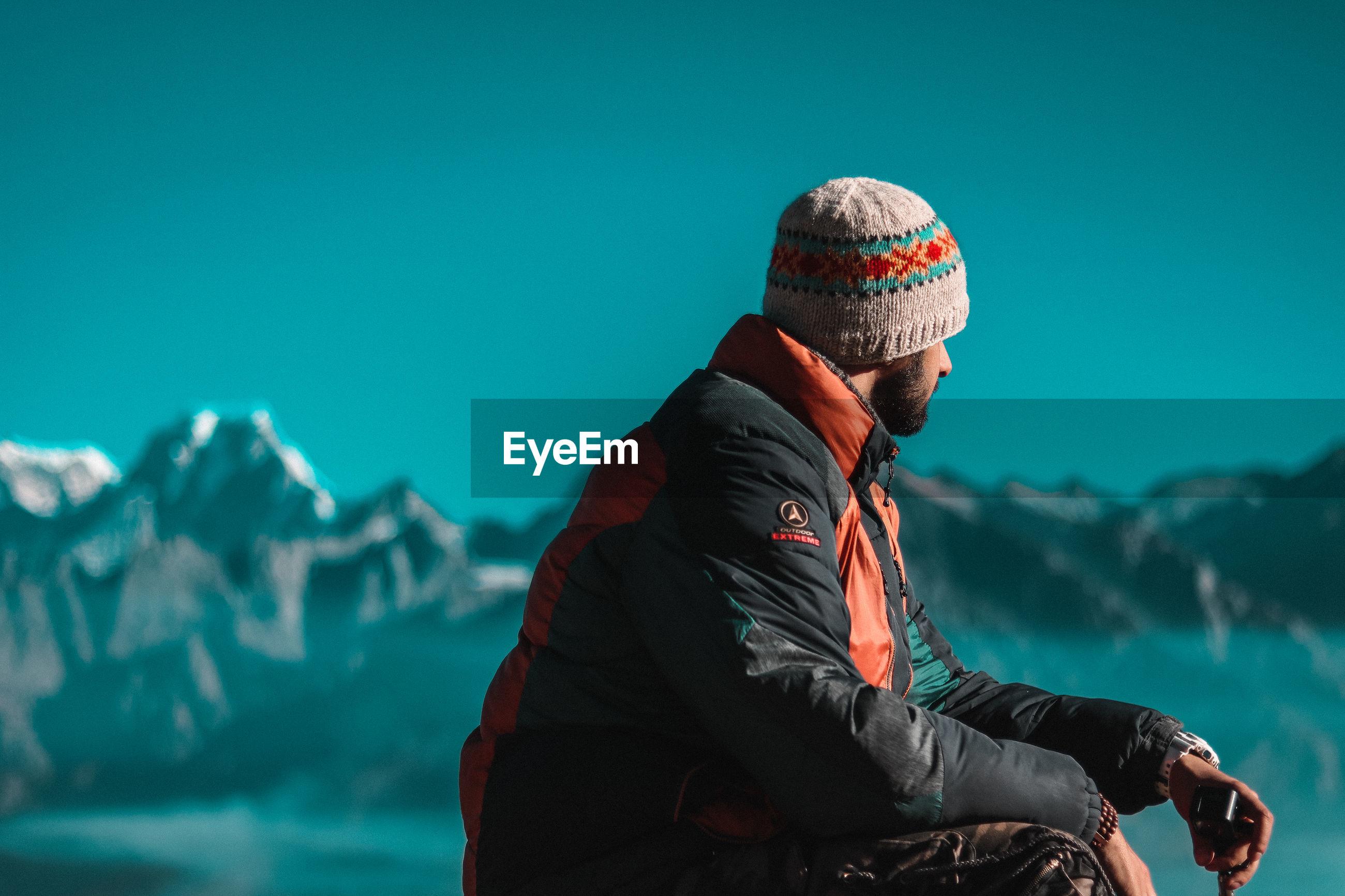 MAN LOOKING AWAY ON SNOW