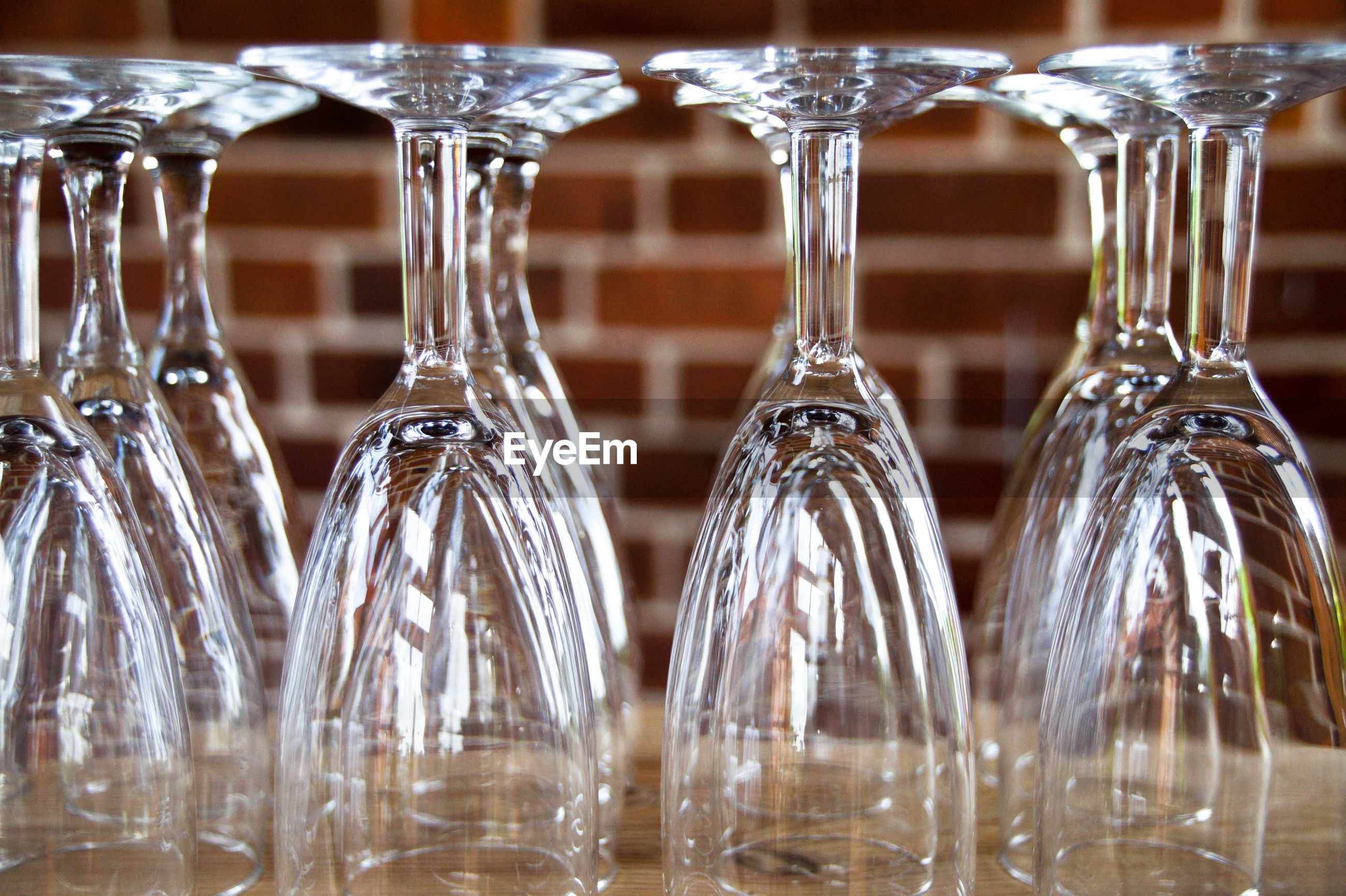 Close-up of upside down wineglasses on table