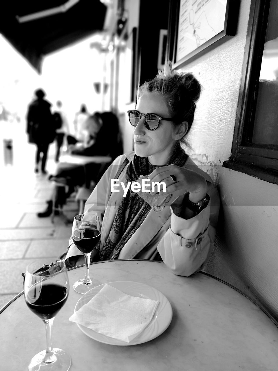Woman looking away while having meal at restaurant
