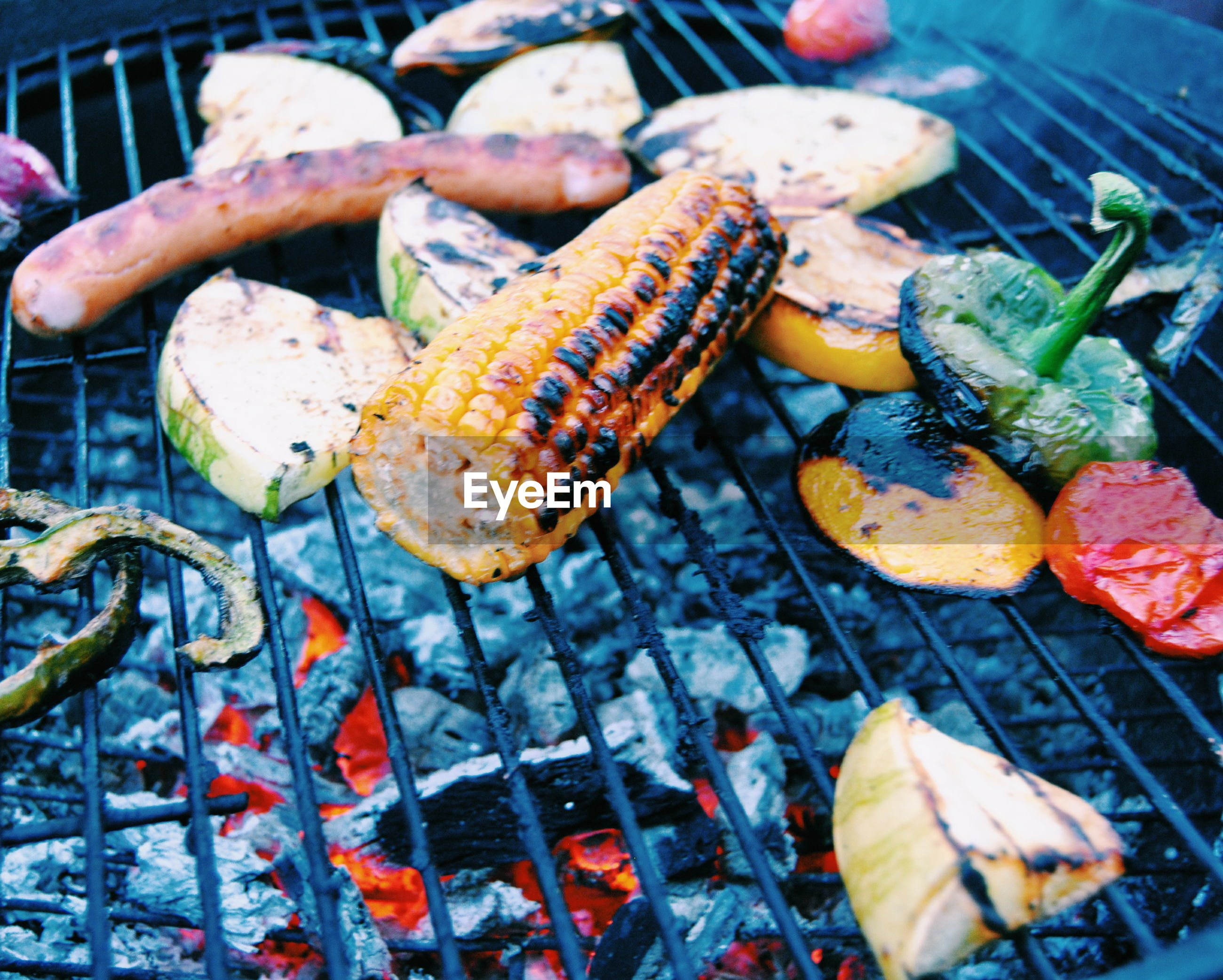 High angle view of various vegetables grilling on barbeque
