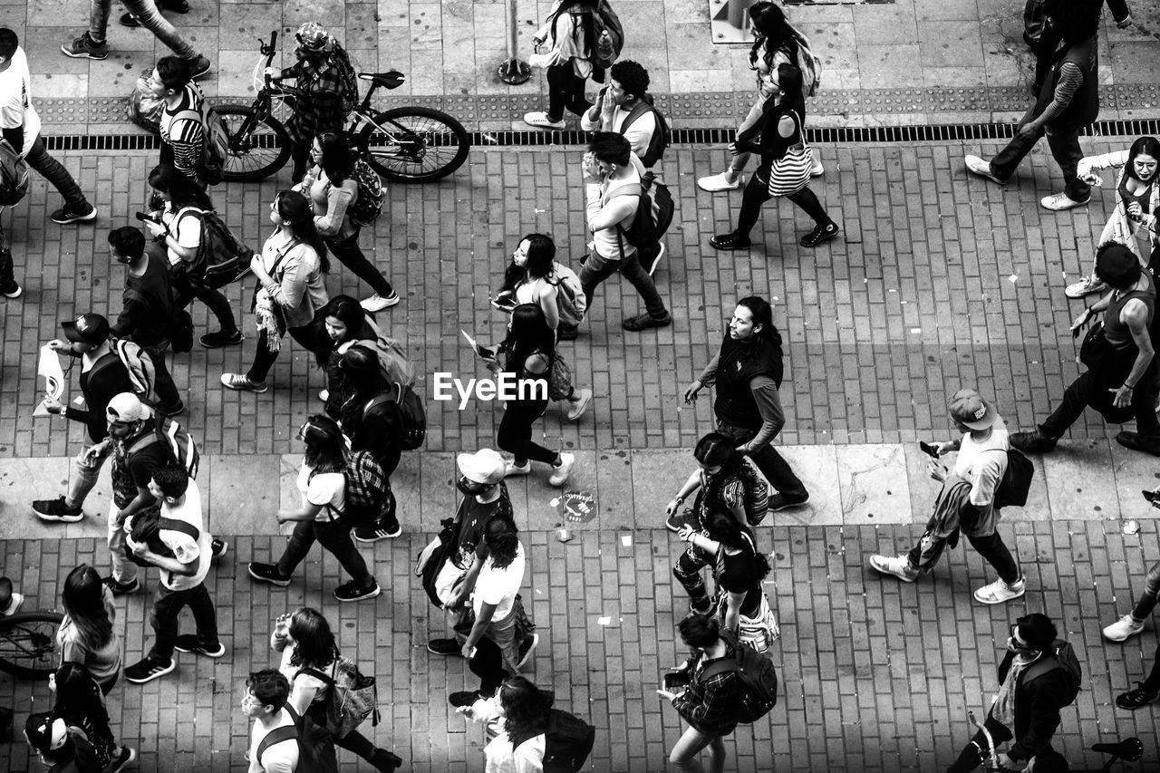 group of people, crowd, large group of people, real people, city, high angle view, men, women, street, architecture, adult, transportation, walking, day, motion, city life, lifestyles, outdoors, road, government