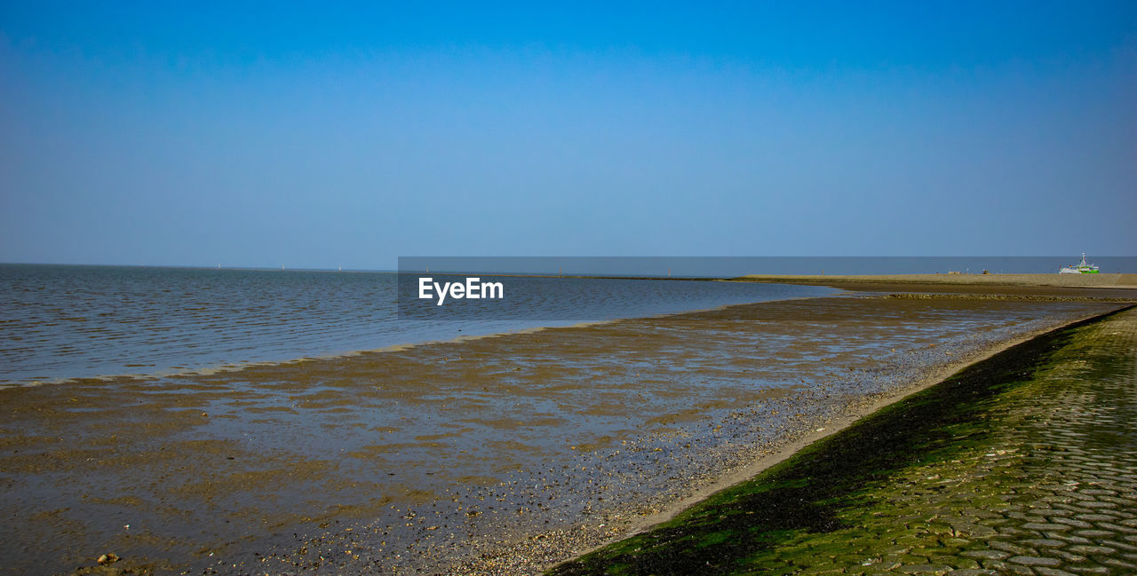 water, sky, sea, clear sky, scenics - nature, beach, tranquility, beauty in nature, tranquil scene, horizon, copy space, nature, land, horizon over water, no people, blue, day, outdoors, non-urban scene