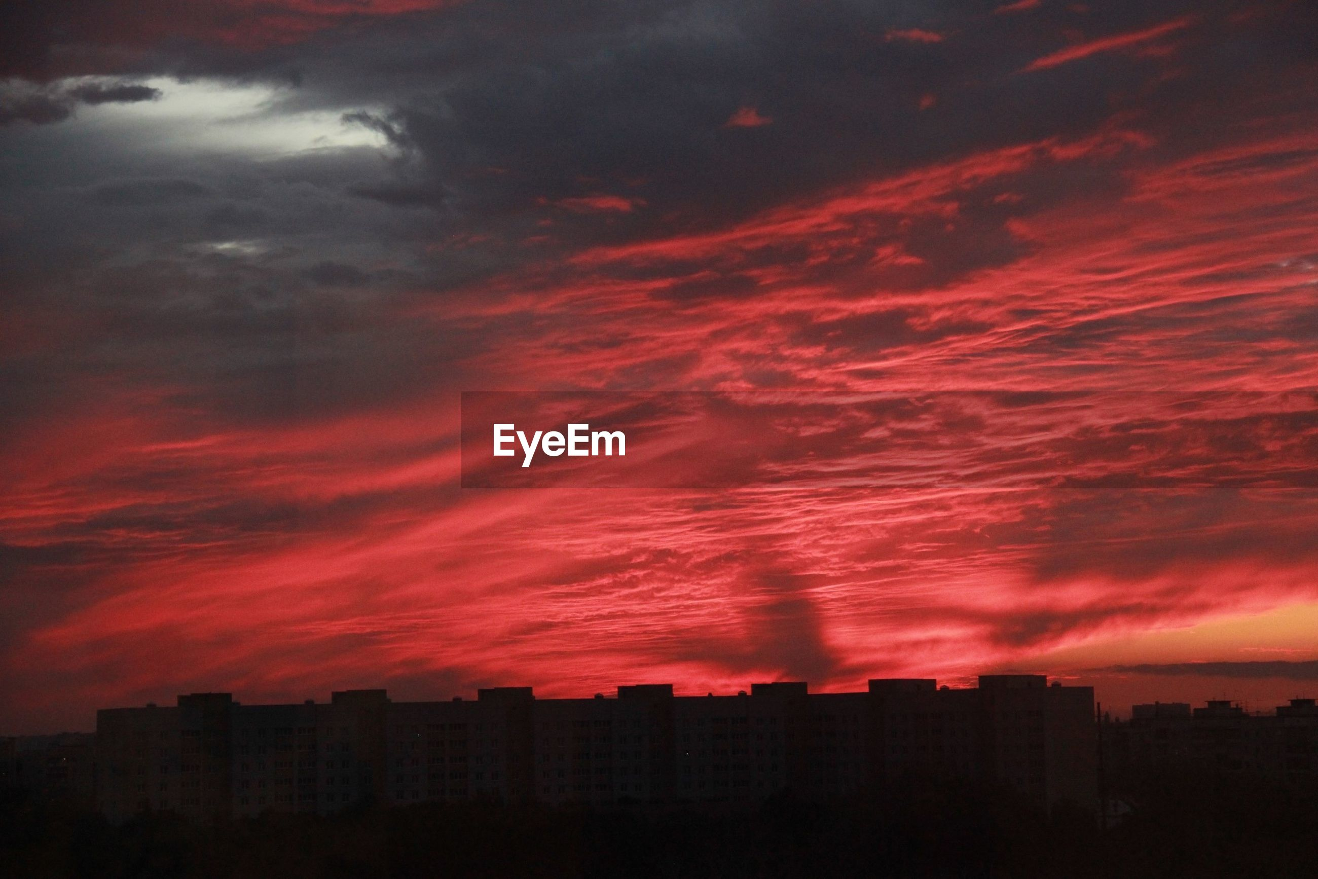 sunset, silhouette, architecture, built structure, building exterior, sky, orange color, cloud - sky, building, scenics, city, beauty in nature, cloud, red, nature, outdoors, dramatic sky, majestic, no people, urban skyline, cloudy, tranquility, residential district, outline