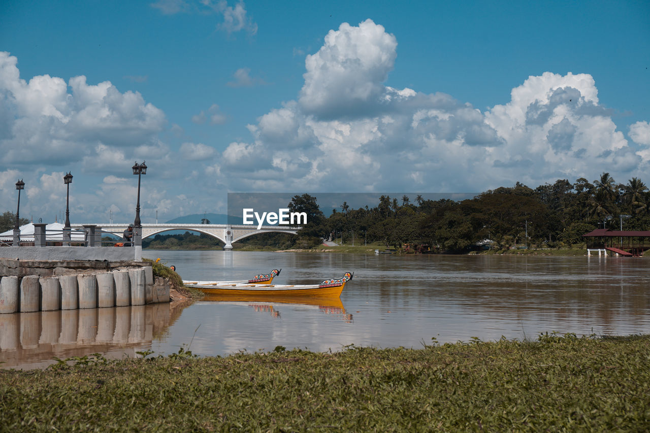 water, sky, cloud - sky, transportation, nature, nautical vessel, plant, built structure, architecture, day, no people, river, mode of transportation, tree, connection, bridge, beauty in nature, outdoors
