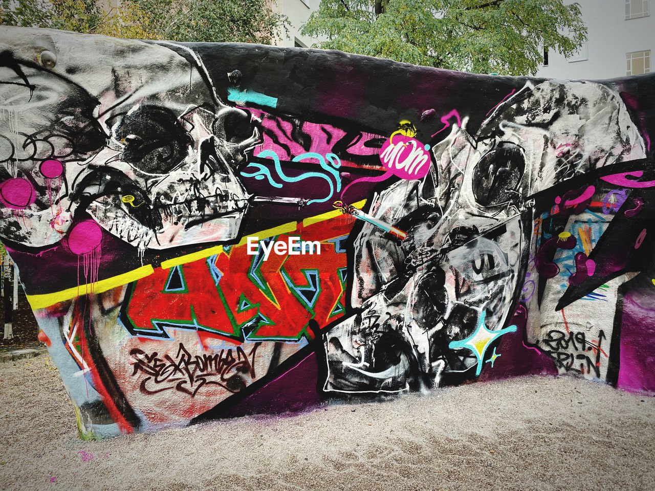 graffiti, art and craft, creativity, multi colored, representation, street art, no people, text, day, wall - building feature, communication, architecture, human representation, built structure, outdoors, western script, mural