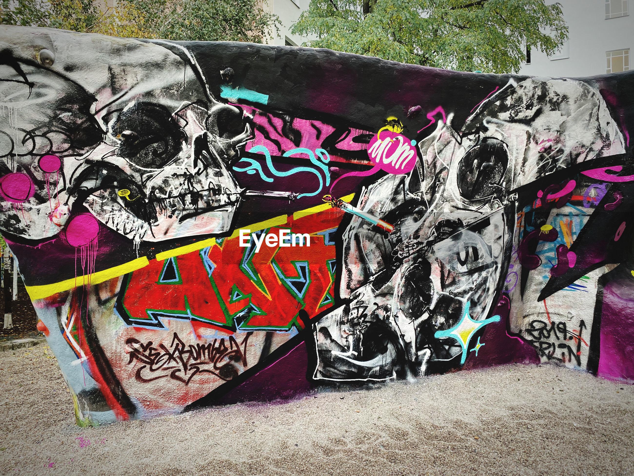 GRAFFITI ON WALL BY TEXT ON BRICK WALLS