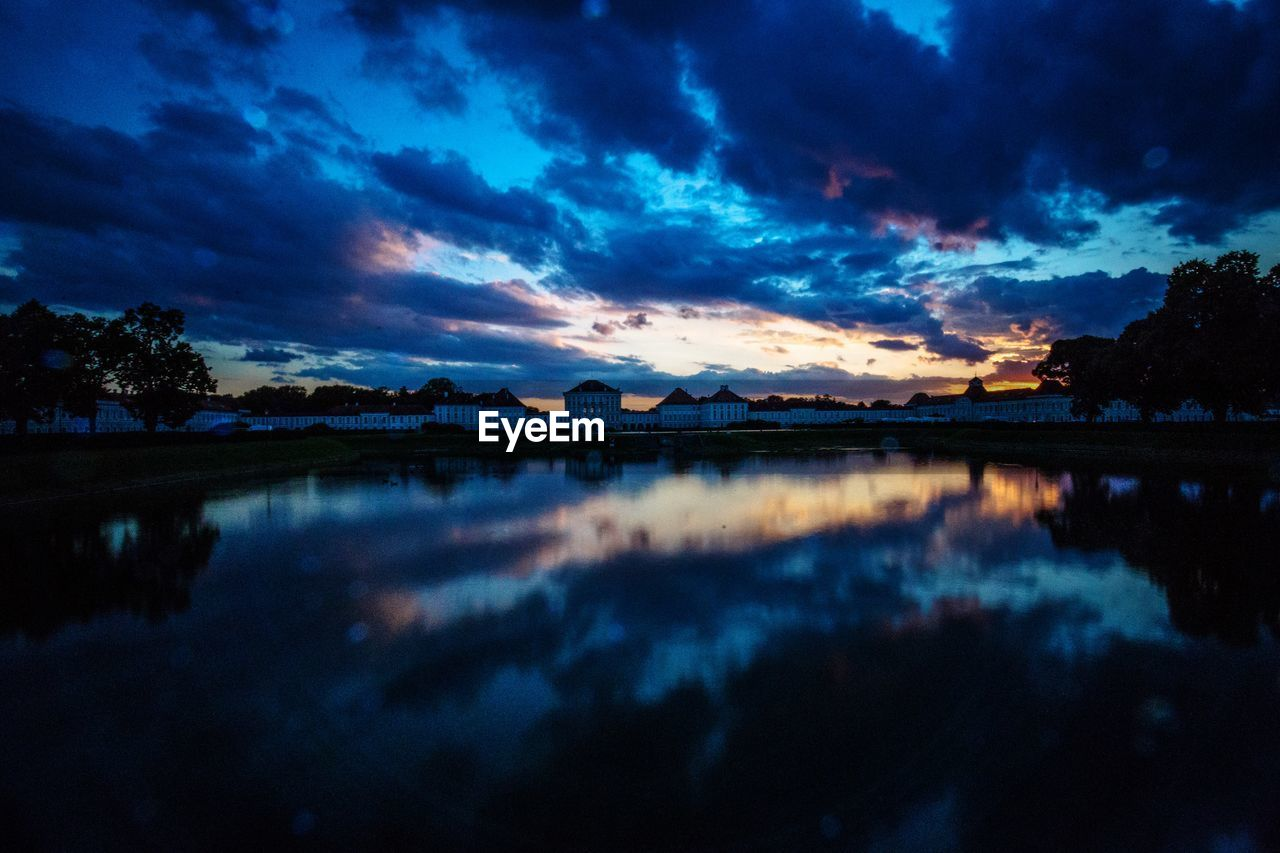 sky, cloud - sky, water, tranquility, sunset, lake, tranquil scene, beauty in nature, scenics - nature, reflection, nature, no people, silhouette, tree, idyllic, non-urban scene, dusk, waterfront, plant, romantic sky
